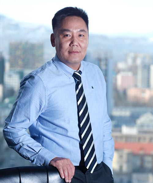 Battulga Norolkhoojav in blue shirt and tie | Startup