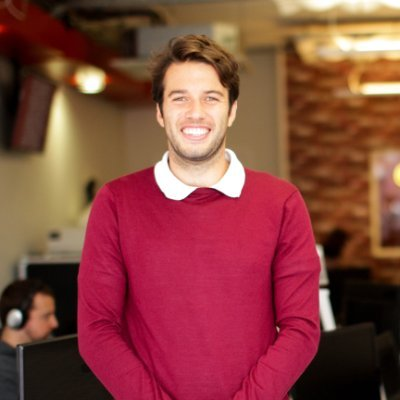 Nick Feneck in red sweater | Software Development